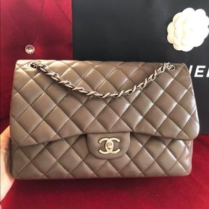 Authentic CHANEL jumbo double flap in Caviar